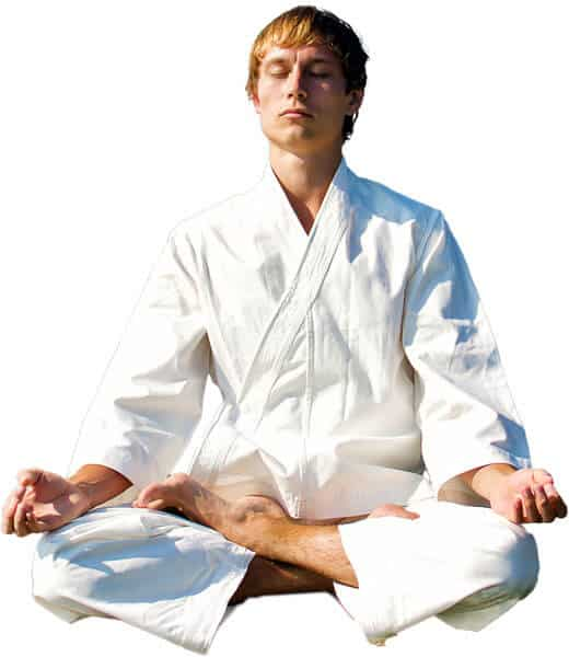 Martial Arts Lessons for Adults in Allen TX - Young Man Thinking and Meditating in White