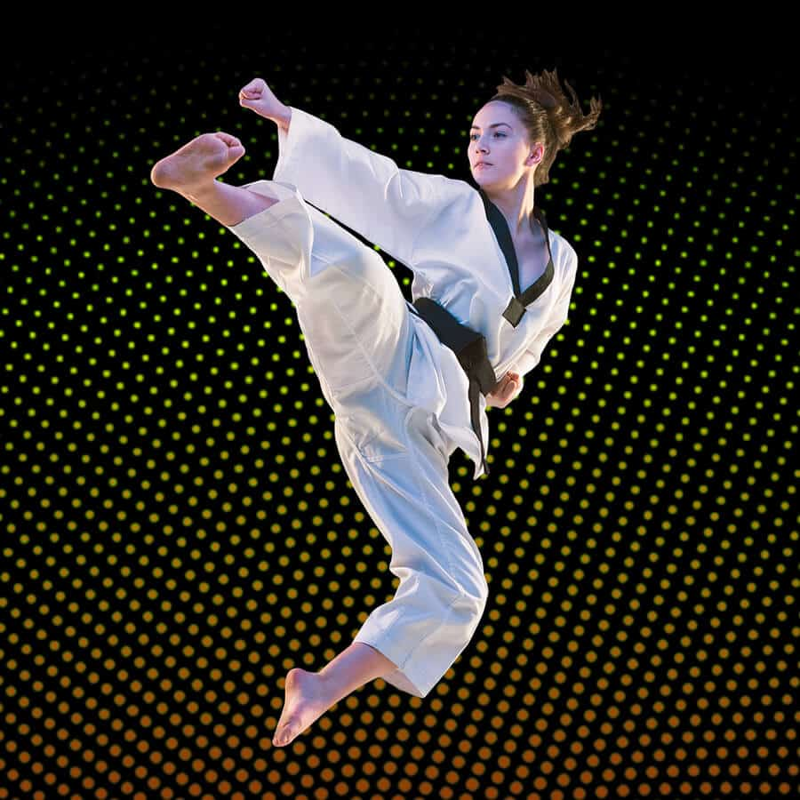 Martial Arts Lessons for Adults in Allen TX - Girl Black Belt Jumping High Kick