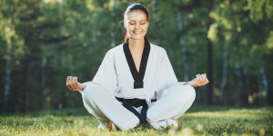Martial Arts Lessons for Adults in Allen TX - Happy Woman Meditated Sitting Background