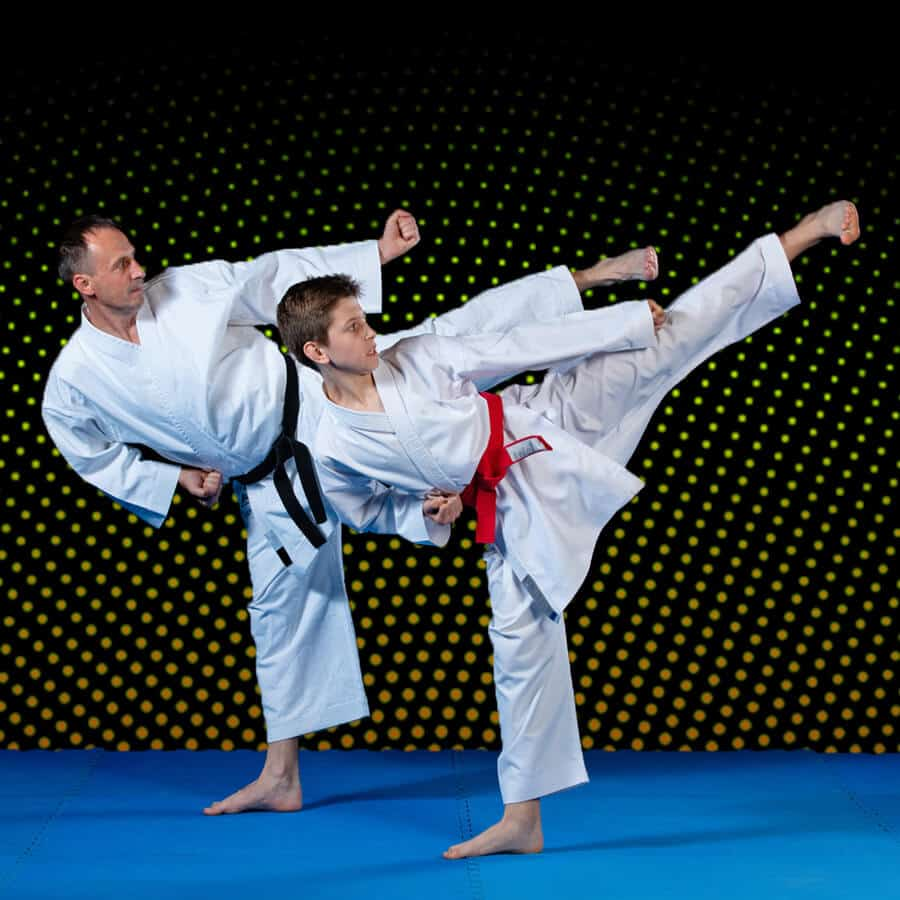 Martial Arts Lessons for Families in Allen TX - Dad and Son High Kick