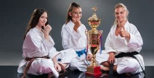 Martial Arts Lessons for Kids in Allen TX - Thumbs Up and Trophies with Sitting Girls